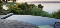 Take a dip in the infinity pool at Royal Chundu