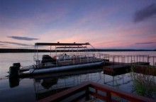 Enjoy a sunset cruise on the Zambezi River while at Royal Chundu